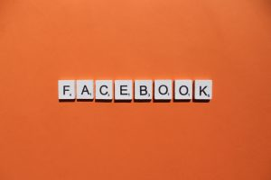 Facebook scrabble letters word on a orange background